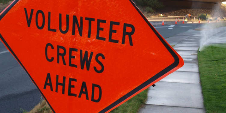 Volunteer crews ahead road sign.