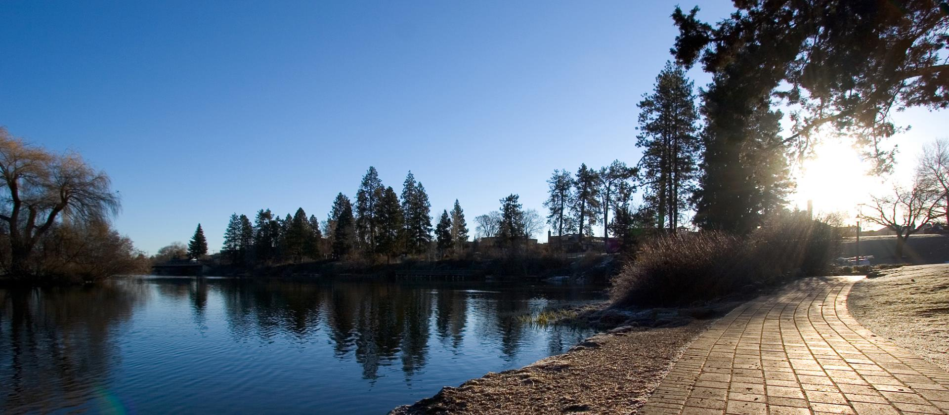 Deschutes River with sun setting over a path.