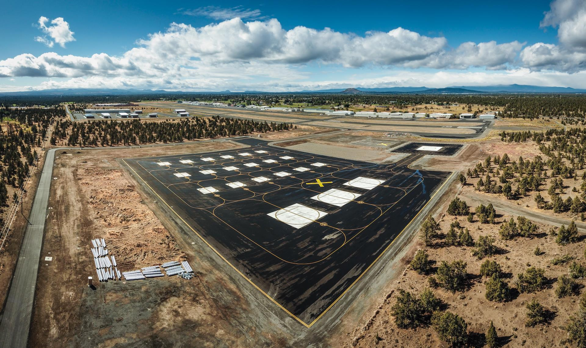 Aerial shot of Bend Municipal Airport with helipads in the foreground.