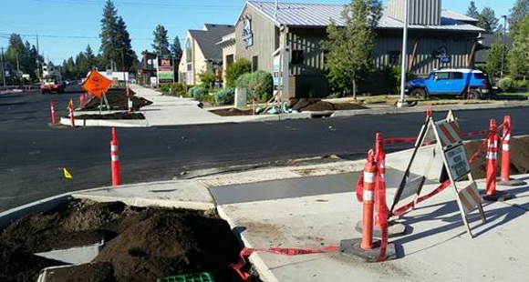 Newly completed sidewalks and freshly paved portions of 14th Street.