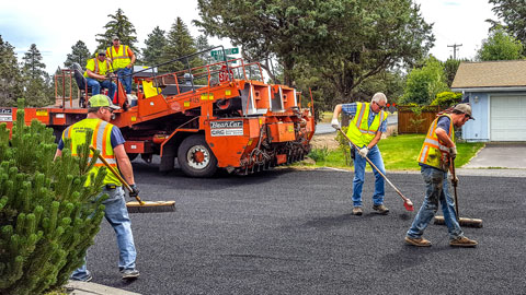 Streets crew applying a chipseal treatment to Bear Creek Rd.