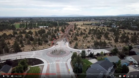 Still frame from YouTube video about Empire Corridor Improvements Project showing aerial view of newly completed roundabout.
