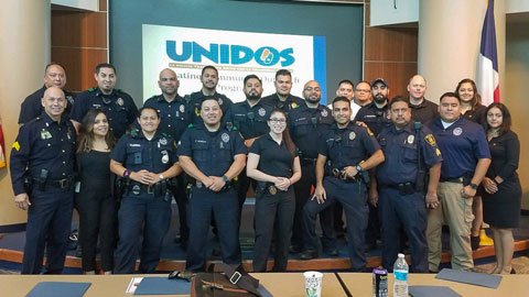 Group of police officers at Unidos event.