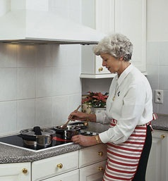 Female Senior Cooking at Stove