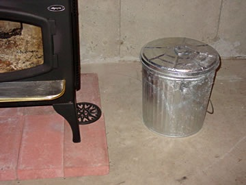 Image of a metal can with a lid for proper disposal of ash and embers out of a wood stove