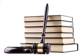 image of gavel leaning against stack of books