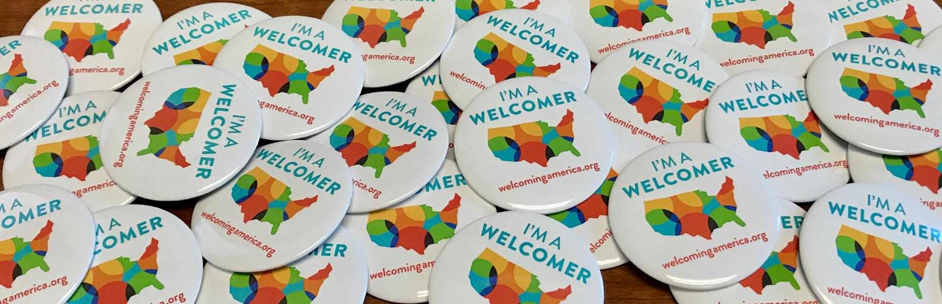 Image of Welcoming Week buttons spread out on table