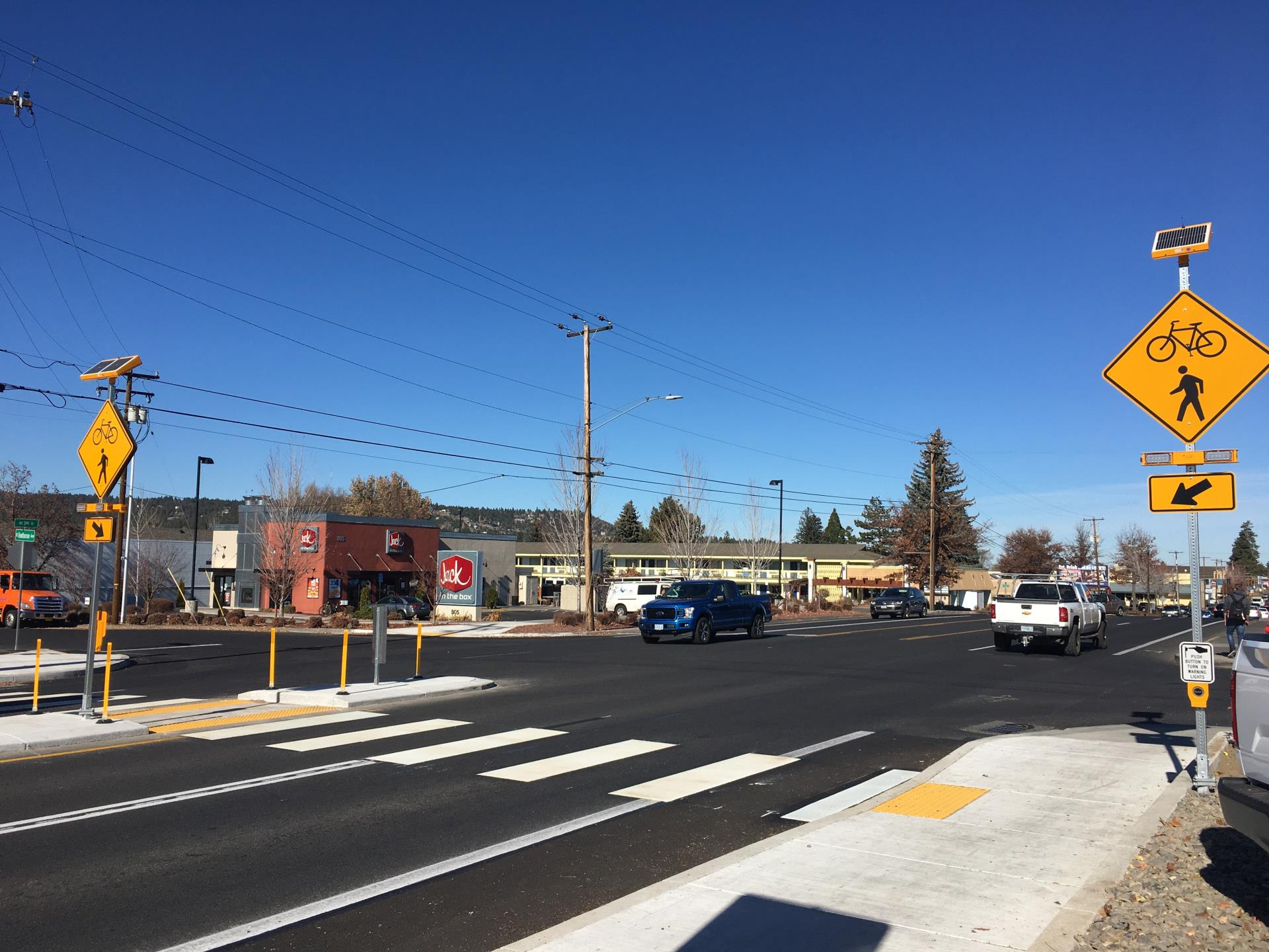 crosswalk and flashing beacons at 3rd Street and Hawthorne Avenue