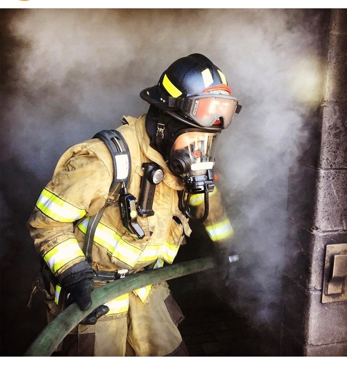 Smokey room with firefighter in full PPE