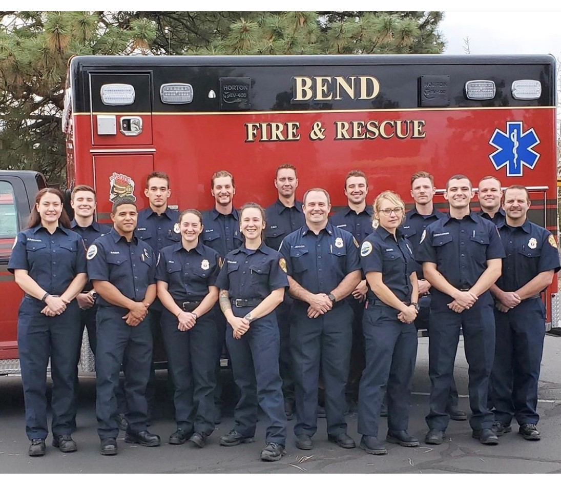 group picture of AO's standing next to ambulance