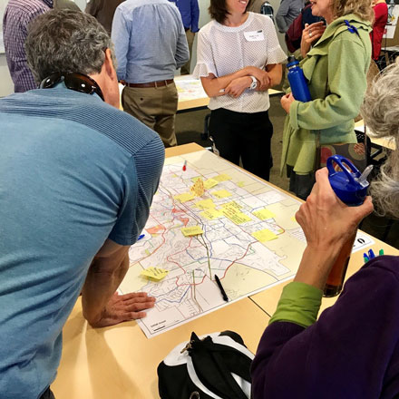 Community members looking at map of Bend.