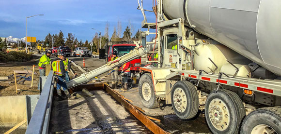 Laying concrete during Empire Boulevard construction.