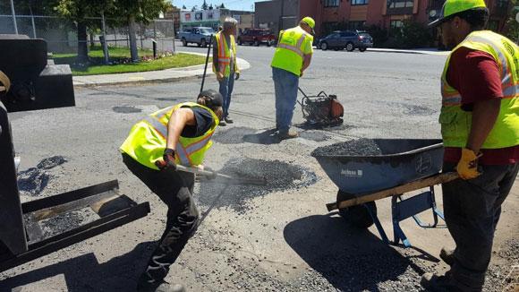 Streets crew fixing potholes.