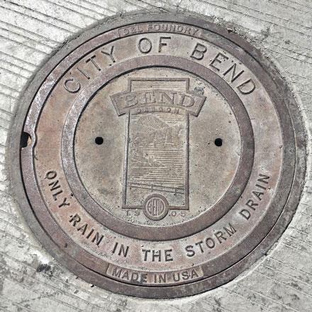 Storm drain manhole cover.