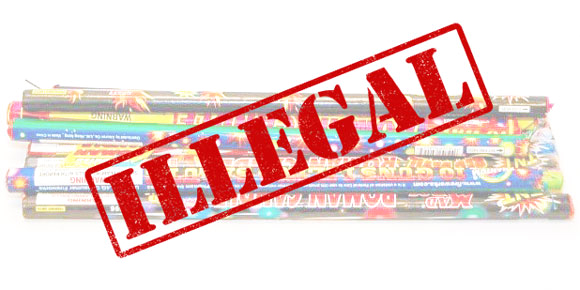 Photo of roman candle fireworks with the words ILLEGAL stamped over the top.