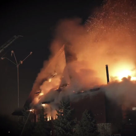Still frame from Before You Light The Fuse video of a house fire.