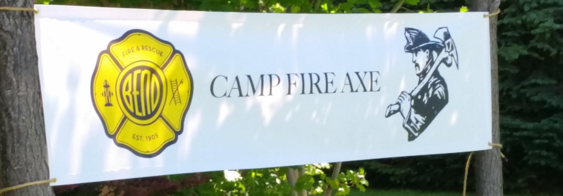 Banner with text Camp Fire Axe; Image of Bend Fire Logo and profile outline of firefighter with helmet and axe